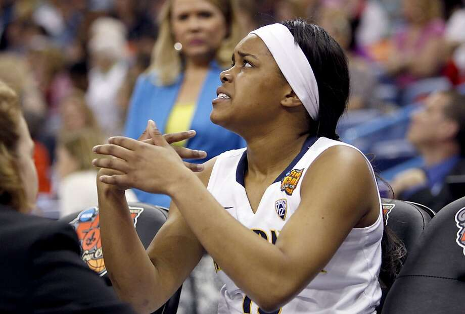 California's Brittany Boyd,(15) tens to an injured finger in the second half as the Cal Berkeley women's basketball team went on to lose to the Louisville Cardinals in the national semi-final game 64-57  in the NCAA Final Four Basketball Tournament in New Orleans, La. on Sunday April 7, 2013. Photo: Michael Macor, The Chronicle