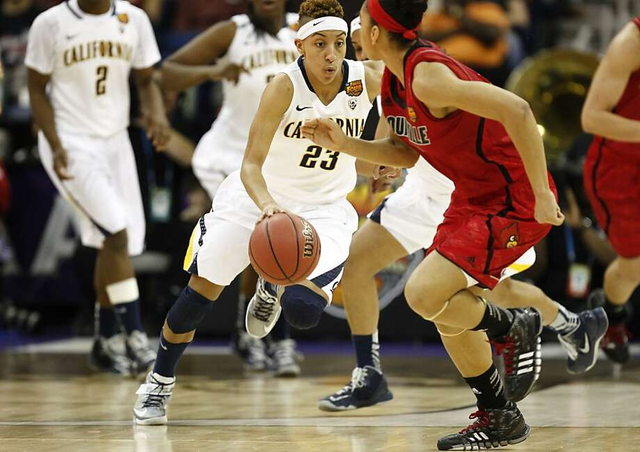 California's Layshia Clarendon,(23) dribbles down court around Louisville's Antonita Slaughter,(4) during first half action as the Cal Berkeley women's basketball team takes on the Louisville Cardinals in the national semi-final match up in the NCAA Final Four Basketball Tournament in New Orleans, La. on Sunday April 7, 2013. Photo: Michael Macor, The Chronicle