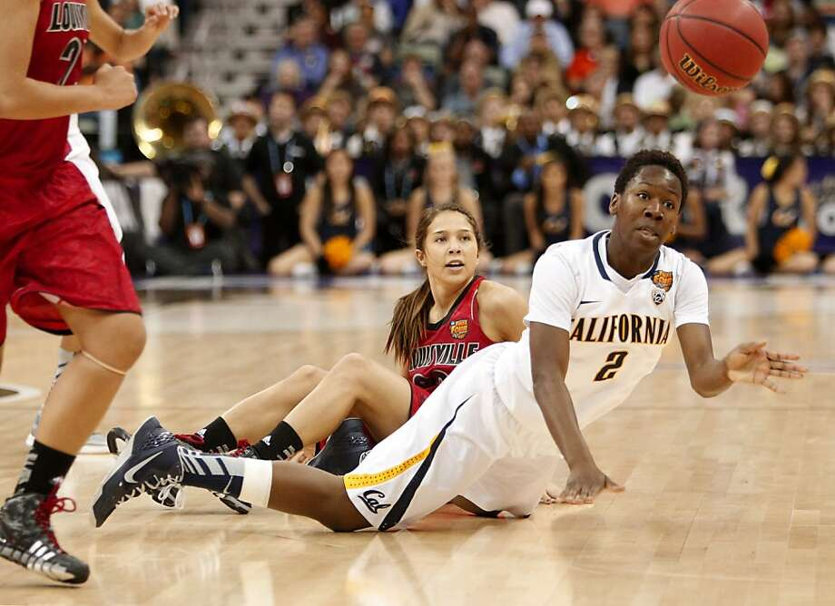 California's Afure Jemerigbe,(2)  gets off a pass while being covered by Louisville's Jude Schimmel,(22) during first half action as the Cal Berkeley women's basketball team takes on the Louisville Cardinals in the national semi-final match up in the NCAA Final Four Basketball Tournament in New Orleans, La. on Sunday April 7, 2013. Photo: Michael Macor, The Chronicle