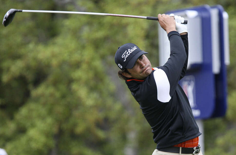 Martin Flores, a former state champion at Clark High, tees off on No. 1 on Sunday at the Valero Texas Open. Flores carded a 4-under 68 during the final round for the third top-10 finish of his career on the PGA Tour. Photo: Jerry Lara / San Antonio Express-News