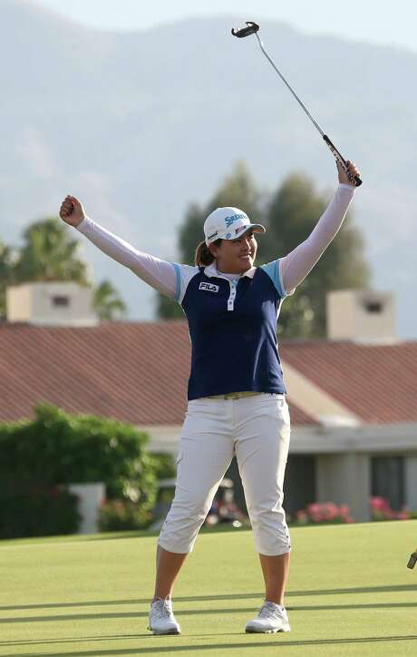 Inbee Park of South Korea celebrates her win in the Kraft Nabisco Championship at Mission Hills, her fourth title in her last 16 events. Photo: Stephen Dunn / Getty Images