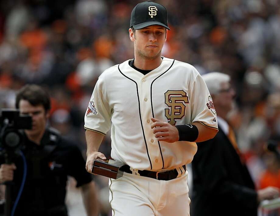 Buster Posey ran off the field to prepare Matt Cain for the game after receiving his ring in a box in his right hand. The San Francisco Giants vs the Saint Louis Cardinals Sunday April 7, 2013 at AT&T park. Photo: Brant Ward, The Chronicle