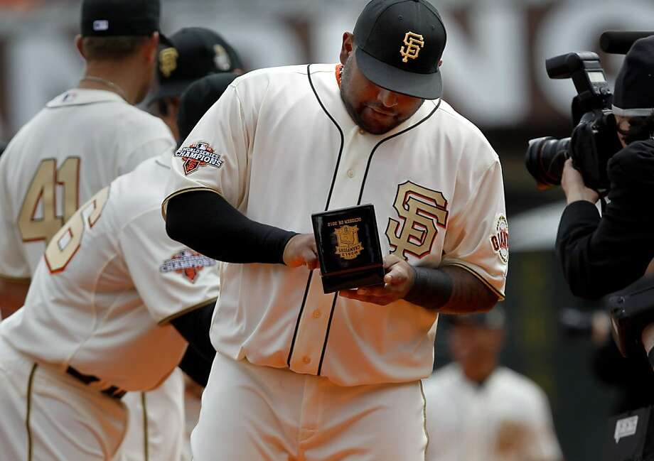 Pablo Sandoval checked out his newest ring during the ceremony. The San Francisco Giants vs the Saint Louis Cardinals Sunday April 7, 2013 at AT&T park. Photo: Brant Ward, The Chronicle
