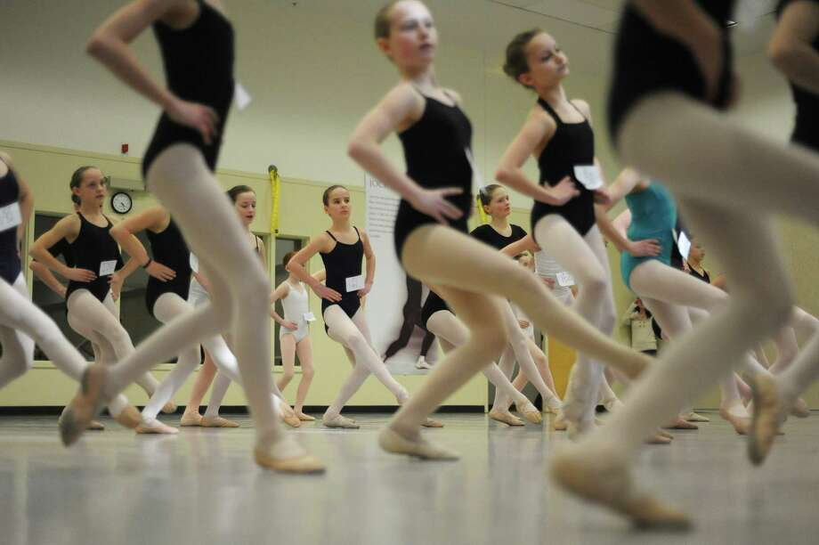Dancers perform steps during auditions at the National Museum of Dance School of the Arts on Sunday, April 7, 2013 in Saratoga Springs, NY.  Girls were auditioning for a chance to dance with New York City Ballet during its Saratoga season.  Sixteen girls were picked to dance in Balanchine?s ?Garland Dance? this summer at SPAC with four girls chosen as alternates.  The performance will be on July 9th, 10th, and the 13th.  (Paul Buckowski / Times Union) Photo: Paul Buckowski