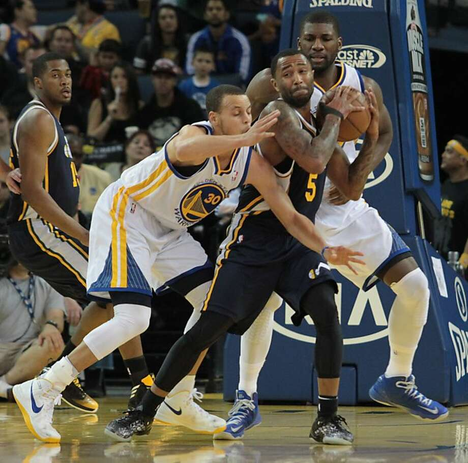 The Warriors' Stephen Curry struggles for the ball with Utah's Mo Williams during a game against the Jazz in Oakland, Calif., on Sunday, April 7, 2013. Photo: Mathew Sumner, Special To The Chronicle