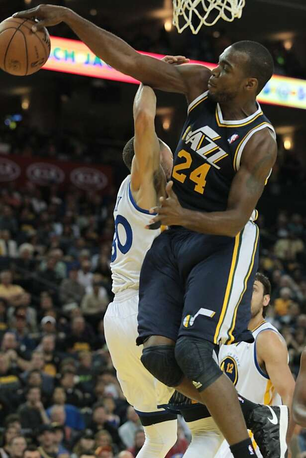 Utah's Paul Millsap blocks a shot by Stephen Curry. The Warriors' point guard scored 22 points, but the Jazz prevailed 97-90, helping their playoff push. Photo: Mathew Sumner, Special To The Chronicle