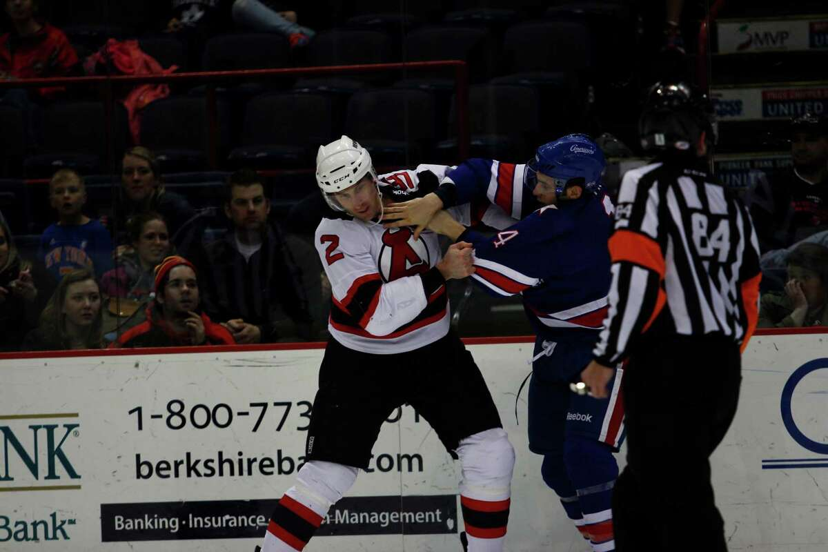 Albany Devil's Jay Leach (2) fights off Rochester American's Alex Biega (4) during their game on Sunday, April 7, 2012 at the Times Union Center in Albany, N.Y. (Dan Little/ Special to the Times Union)