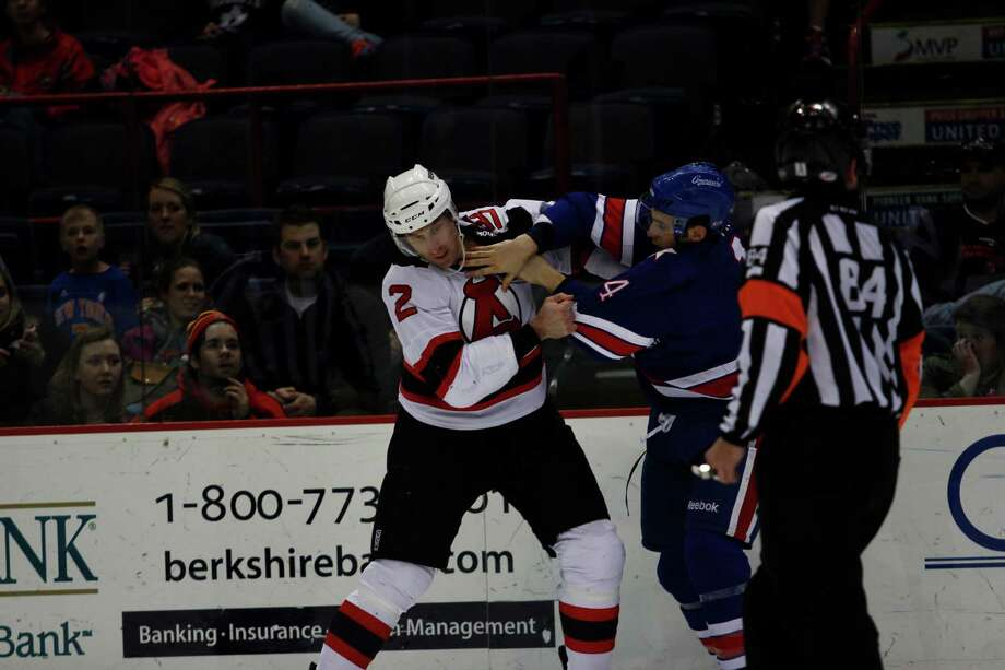 Albany Devil's Jay Leach (2) fights off Rochester American's Alex Biega (4) during their game on Sunday, April 7, 2012 at the Times Union Center in Albany, N.Y. (Dan Little/ Special to the Times Union) Photo: Dan Little / Dan Little