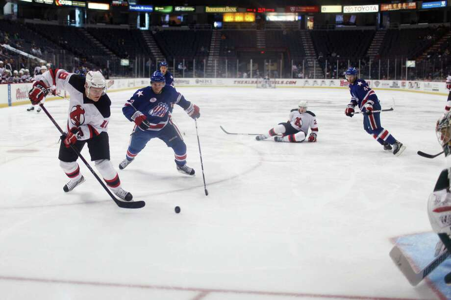 Albany Devil's Harri Pesonen (18) takes a shot on the Rochester American's goal during their game on Sunday, April 7, 2012 at the Times Union Center in Albany, N.Y. (Dan Little/ Special to the Times Union) Photo: Dan Little / Dan Little