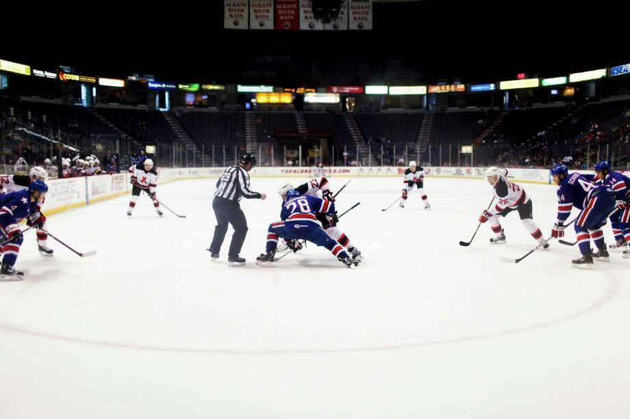 The Albany Devils face off against the Rochester Americans during their game on Sunday, April 7, 2012 at the Times Union Center in Albany, N.Y. (Dan Little/ Special to the Times Union) Photo: Dan Little / Dan Little
