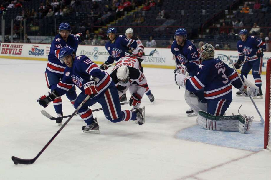 Rochester American's Alex Biega (4) clears the puck away from the goal during their game against the Albany Devils on Sunday, April 7, 2012 at the Times Union Center in Albany, N.Y. (Dan Little/ Special to the Times Union) Photo: Dan Little / Dan Little