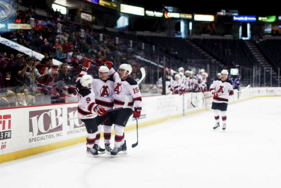 The Albany Devils celebrate after Reid Boucher (20) scores the first goal against the Rochester Americans during their game on Sunday, April 7, 2012 at the Times Union Center in Albany, N.Y. (Dan Little/ Special to the Times Union) Photo: Dan Little / Dan Little