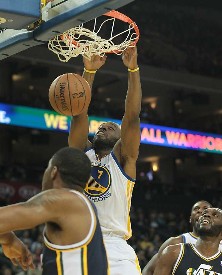 The Warriors' Carl Landry dunks the ball during a game against the Jazz in Oakland, Calif., on Sunday, April 7, 2013. Photo: Mathew Sumner, Special To The Chronicle
