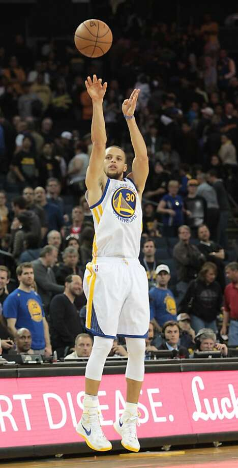 The Warriors' Stephen Curry puts up a three-point shot during a game against the Jazz in Oakland, Calif., on Sunday, April 7, 2013. Photo: Mathew Sumner, Special To The Chronicle