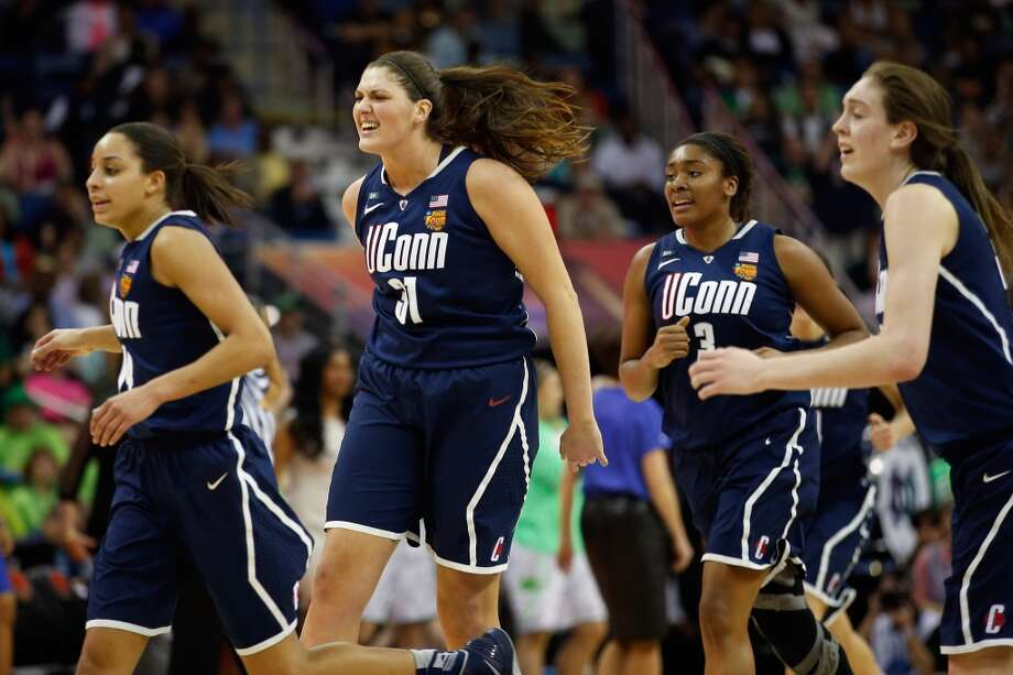 NEW ORLEANS, LA - APRIL 07:  Members of the Connecticut Huskies react during the game against the Notre Dame Fighting Irish during the National Semifinal game of the 2013 NCAA Division I Women's Basketball Championship at the New Orleans Arena on April 7, 2013 in New Orleans, Louisiana.  (Photo by Chris Graythen/Getty Images)