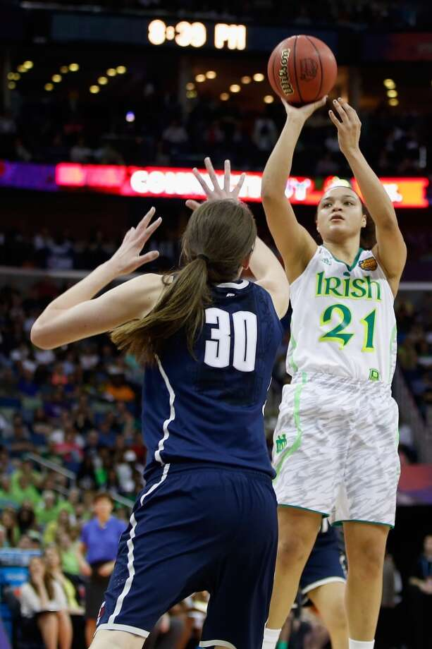 NEW ORLEANS, LA - APRIL 07:  Kayla McBride #21 of the Notre Dame Fighting Irish makes a shot over Breanna Stewart #30 of the Connecticut Huskies during the National Semifinal game of the 2013 NCAA Division I Women's Basketball Championship at the New Orleans Arena on April 7, 2013 in New Orleans, Louisiana.  (Photo by Chris Graythen/Getty Images)