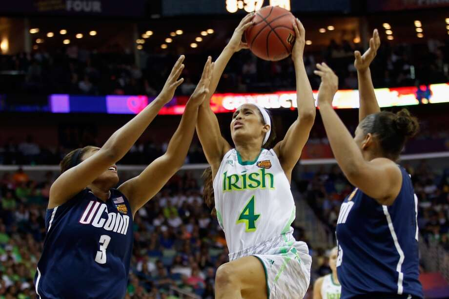 NEW ORLEANS, LA - APRIL 07:  Skylar Diggins #4 of the Notre Dame Fighting Irish makes a shot over Morgan Tuck #3 of the Connecticut Huskies during the National Semifinal game of the 2013 NCAA Division I Women's Basketball Championship at the New Orleans Arena on April 7, 2013 in New Orleans, Louisiana.  (Photo by Chris Graythen/Getty Images)