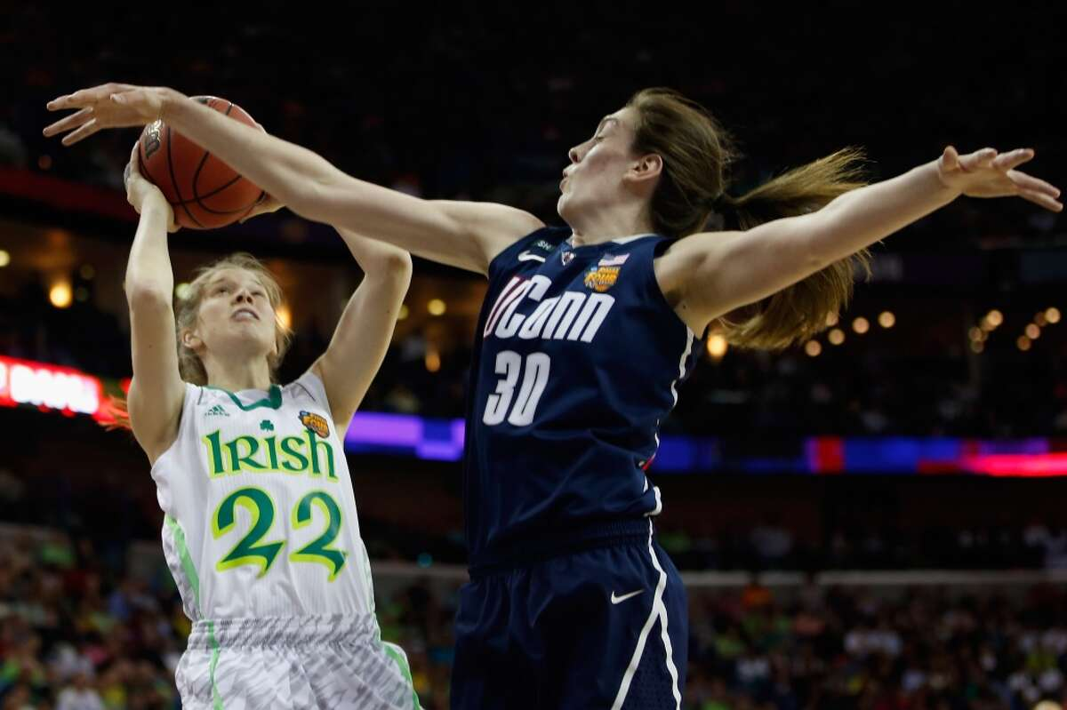 NEW ORLEANS, LA - APRIL 07: Madison Cable #22 of the Notre Dame Fighting Irish makes a shot over Breanna Stewart #30 of the Connecticut Huskies during the National Semifinal game of the 2013 NCAA Division I Women's Basketball Championship at the New Orleans Arena on April 7, 2013 in New Orleans, Louisiana. (Photo by Chris Graythen/Getty Images)