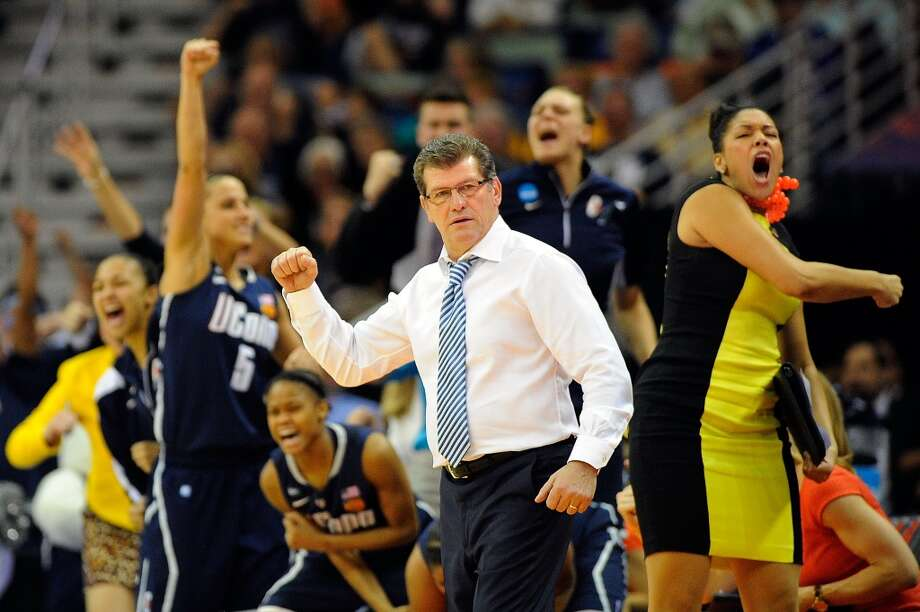 NEW ORLEANS, LA - APRIL 07: Geno Auriemma, head coach of the Connecticut Huskies reacts to a three point shot against the Notre Dame Fighting Irish during the National Semifinal game of the 2013 NCAA Division I Women's Basketball Championship at New Orleans Arena on April 7, 2013 in New Orleans, Louisiana. (Photo by Stacy Revere/Getty Images)
