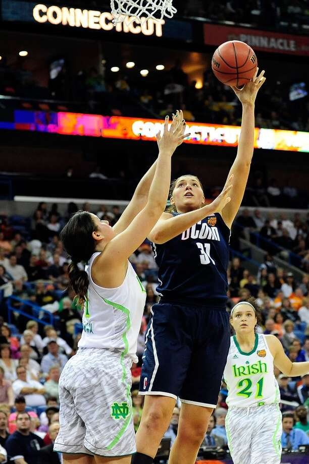 NEW ORLEANS, LA - APRIL 07: Stefanie Dolson #31 of the Connecticut Huskies shoots against the Notre Dame Fighting Irish during the National Semifinal game of the 2013 NCAA Division I Women's Basketball Championship at New Orleans Arena on April 7, 2013 in New Orleans, Louisiana. (Photo by Stacy Revere/Getty Images)