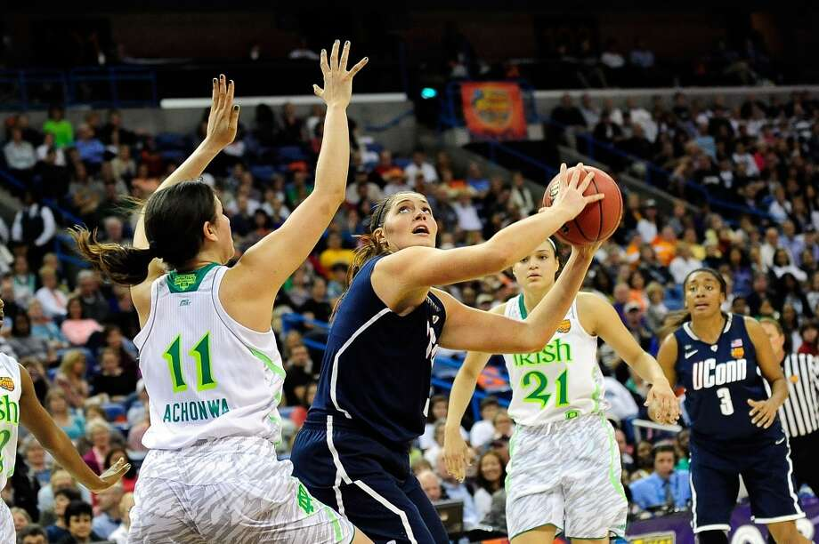 NEW ORLEANS, LA - APRIL 07: Stefanie Dolson #31 of the Connecticut Huskies looks to shoot over Natalie Achonwa #11 of the Notre Dame Fighting Irish during the National Semifinal game of the 2013 NCAA Division I Women's Basketball Championship at New Orleans Arena on April 7, 2013 in New Orleans, Louisiana. (Photo by Stacy Revere/Getty Images)