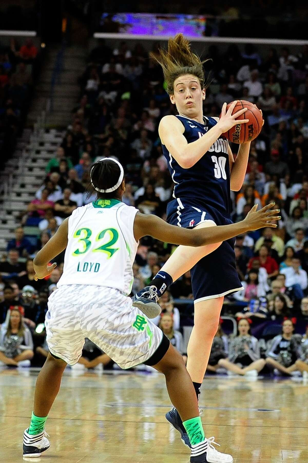 NEW ORLEANS, LA - APRIL 07: Breanna Stewart #30 of the Connecticut Huskies grabs an inbound pass in front of Jewell Loyd #32 of the Notre Dame Fighting Irish during the National Semifinal game of the 2013 NCAA Division I Women's Basketball Championship at New Orleans Arena on April 7, 2013 in New Orleans, Louisiana. (Photo by Stacy Revere/Getty Images)