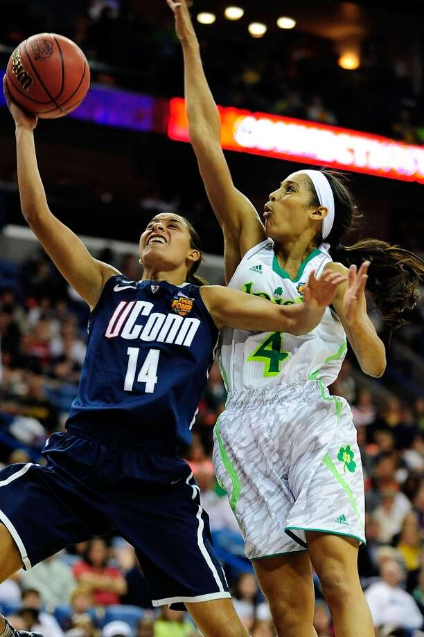 NEW ORLEANS, LA - APRIL 07: Skylar Diggins #4 of the Notre Dame Fighting Irish defends a shot by Bria Hartley #14 of the Connecticut Huskies during the National Semifinal game of the 2013 NCAA Division I Women's Basketball Championship at New Orleans Arena on April 7, 2013 in New Orleans, Louisiana. (Photo by Stacy Revere/Getty Images)