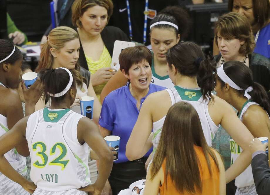 Notre Dame head coach Muffet McGraw talks to her team during a timeout against Connecticut in the first half of the women's NCAA Final Four college basketball tournament semifinal against Connecticut, Sunday, April 7, 2013, in New Orleans. (AP Photo/Bill Haber)
