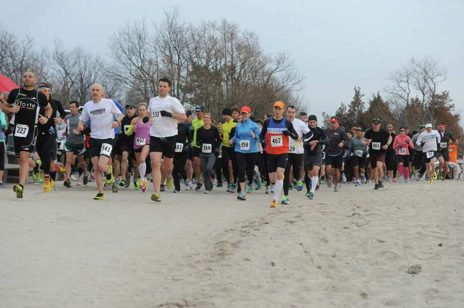 The start of first Greenwich Half Marathon hosted by Threads & Treads at Greenwich Point in Old Greenwich, Conn., Sunday April 7, 2013. Photo: Helen Neafsey / Greenwich Time
