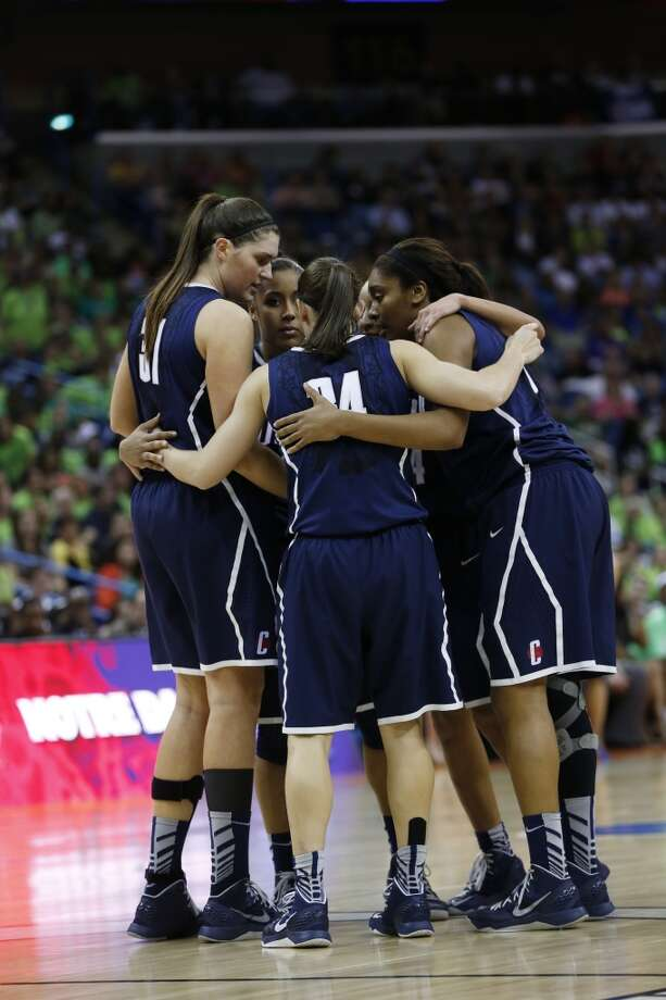 Connecticut players huddle in the second half of the women's NCAA Final Four college basketball tournament semifinal against Notre Dame, Sunday, April 7, 2013, in New Orleans. (AP Photo/Dave Martin)