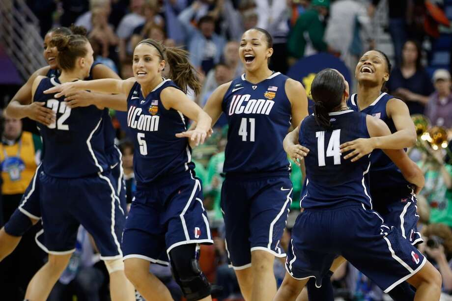 NEW ORLEANS, LA - APRIL 07:  Members of the Connecticut Huskies celebrate after defeating the Notre Dame Fighting Irish 83-65 during the National Semifinal game of the 2013 NCAA Division I Women's Basketball Championship at the New Orleans Arena on April 7, 2013 in New Orleans, Louisiana.  (Photo by Chris Graythen/Getty Images)
