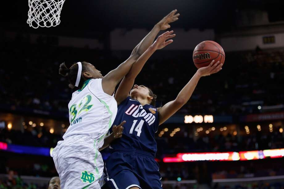 NEW ORLEANS, LA - APRIL 07:  Bria Hartley #14 of the Connecticut Huskies shoots the ball over Jewell Loyd #32 of the Notre Dame Fighting Irish during the National Semifinal game of the 2013 NCAA Division I Women's Basketball Championship at the New Orleans Arena on April 7, 2013 in New Orleans, Louisiana.  (Photo by Chris Graythen/Getty Images)