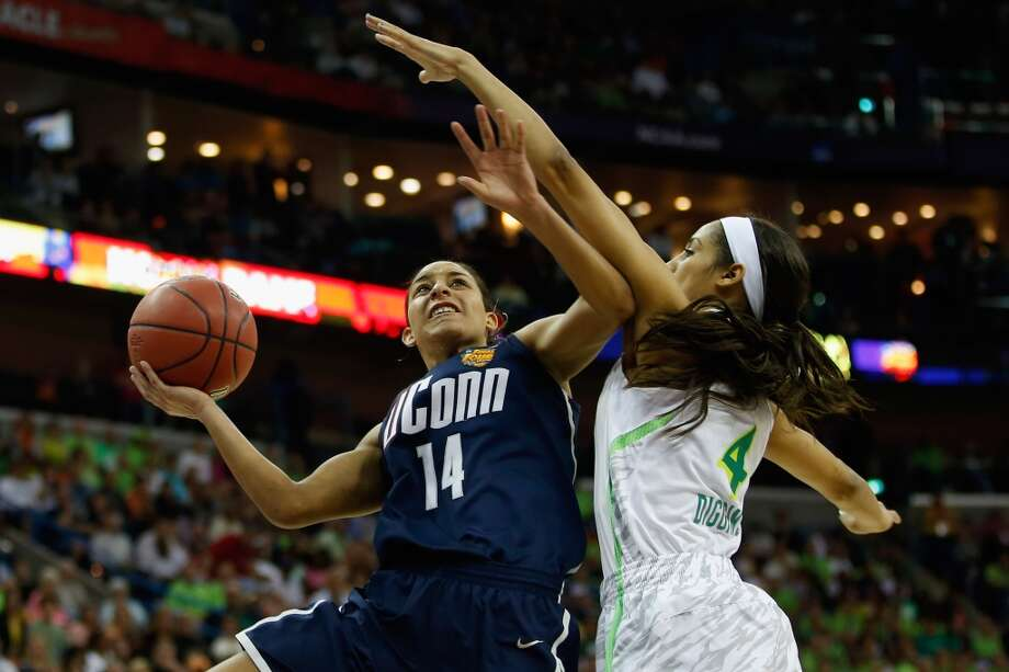 NEW ORLEANS, LA - APRIL 07:  Bria Hartley #14 of the Connecticut Huskies shoots the ball over Skylar Diggins #4 of the Notre Dame Fighting Irish during the National Semifinal game of the 2013 NCAA Division I Women's Basketball Championship at the New Orleans Arena on April 7, 2013 in New Orleans, Louisiana.  (Photo by Chris Graythen/Getty Images)