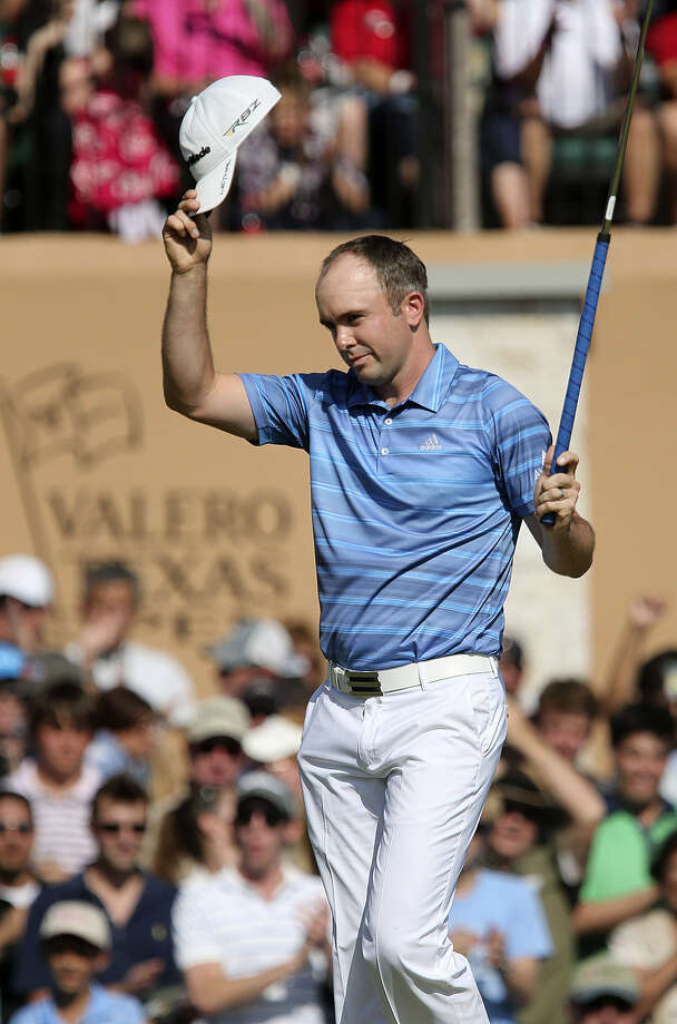Martin Laird of Scotland makes birdie on No. 18 to close out his Valero Texas Open victory. Laird, who missed the cut the week before in Houston, clinched a Masters berth and took home $1.116 million with a 63. Photo: Jerry Lara / San Antonio Express-News