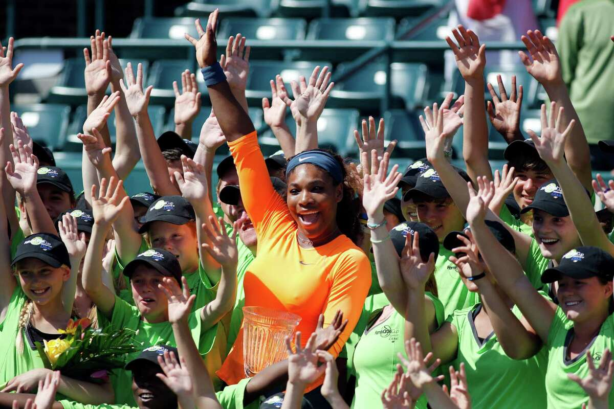 The ball boys and ball girls join Serena Williams in celebrating her win in Charleston, S.C.