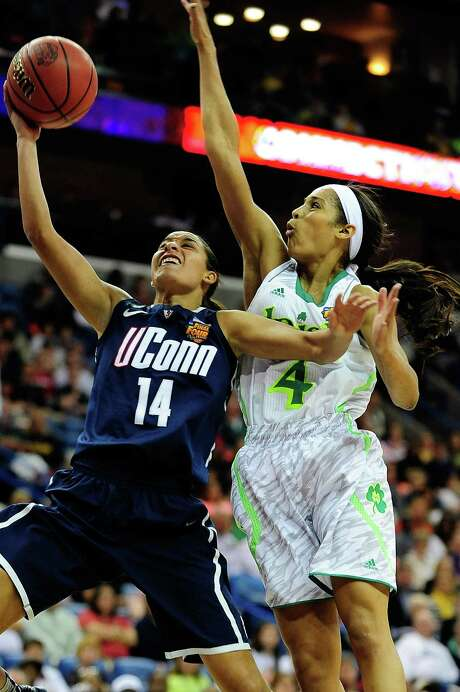 Notre Dame star Skylar Diggins (right), trying to stop UConn's Bria Hartley, scored only 10 points in her last college game. Photo: Stacy Revere / Getty Images