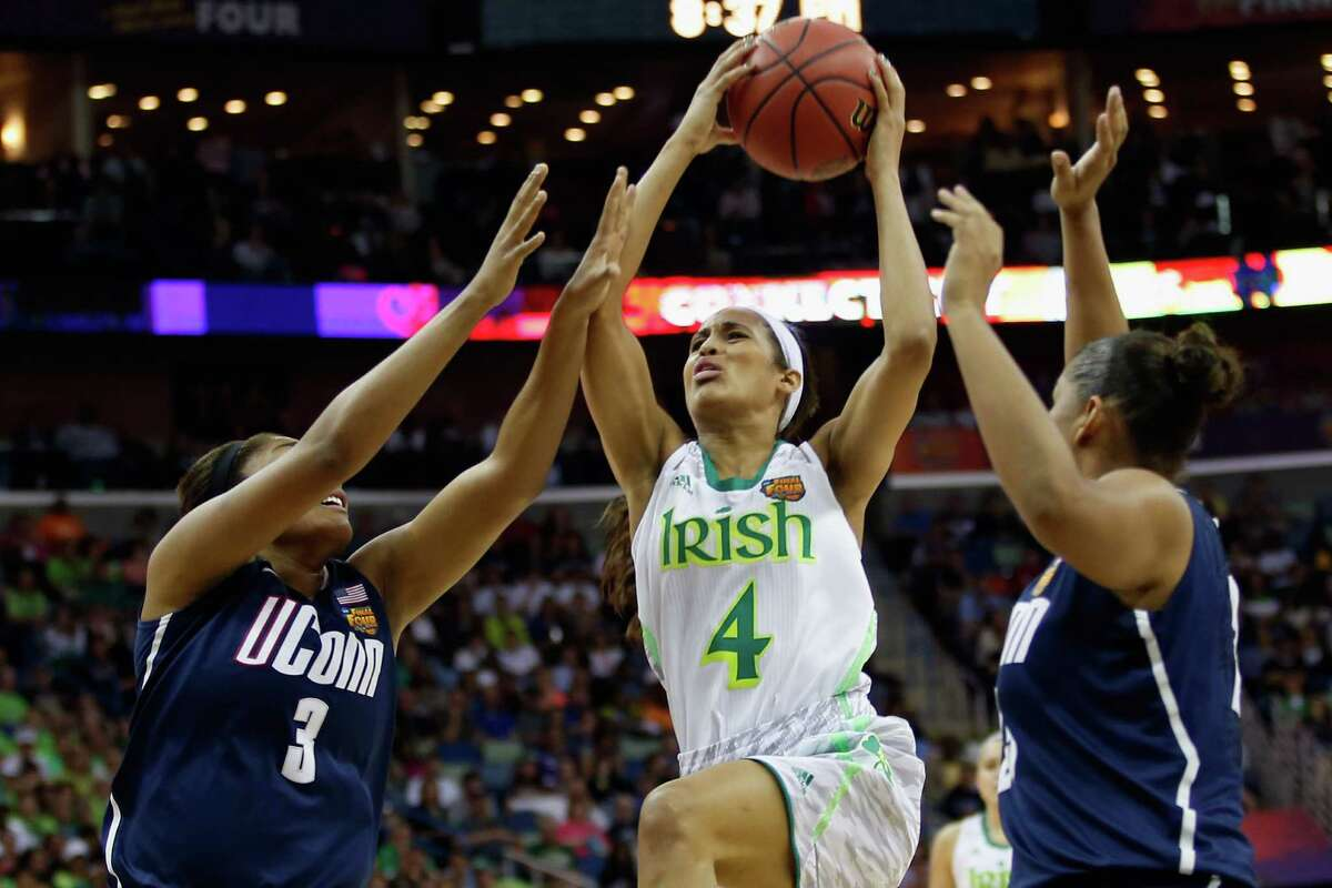 Connecticut harassed Notre Dame star Skylar Diggins (4) into a 3-for-15 shooting night Sunday, ending her successful career in less-than-memorable fashion.