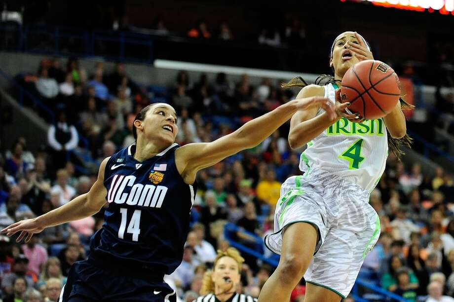 NEW ORLEANS, LA - APRIL 07: Skylar Diggins #4 of the Notre Dame Fighting Irish is defended by Bria Hartley #14 of the Connecticut Huskies during the National Semifinal game of the 2013 NCAA Division I Women's Basketball Championship at the New Orleans Arena on April 7, 2013 in New Orleans, Louisiana. Connecticut won the game 83-65. (Photo by Stacy Revere/Getty Images)