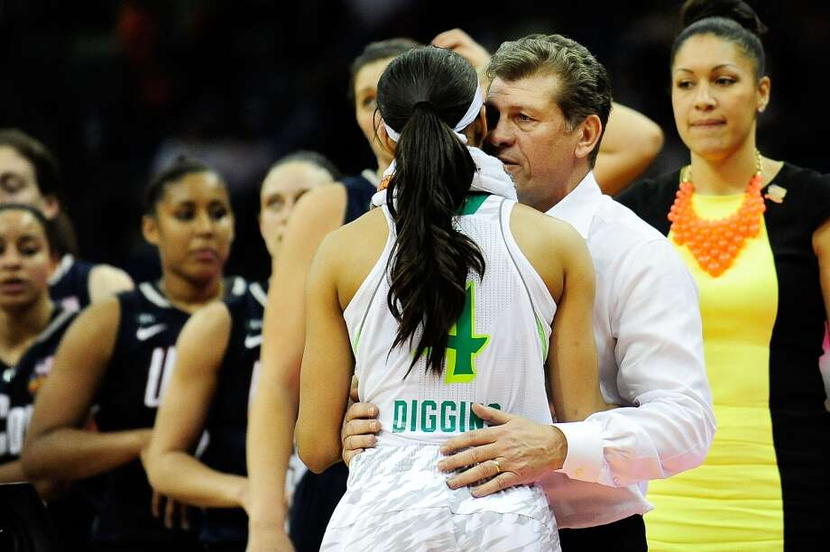 NEW ORLEANS, LA - APRIL 07: Skylar Diggins #4 of the Notre Dame Fighting Irish embraces Geno Auriemma, head coach of the Connecticut Huskies following the National Semifinal game of the 2013 NCAA Division I Women's Basketball Championship at the New Orleans Arena on April 7, 2013 in New Orleans, Louisiana. Connecticut won the game 83-65. (Photo by Stacy Revere/Getty Images)