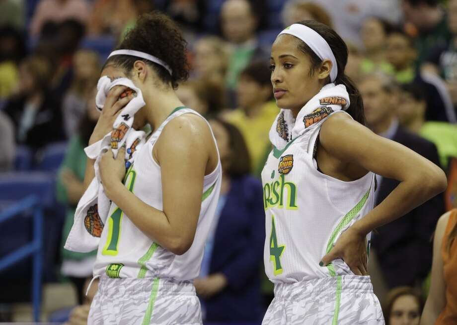 Notre Dame guard Kayla McBride (21) and guard Skylar Diggins (4) react at the end of the women's NCAA Final Four college basketball tournament semifinal Connecticut, Sunday, April 7, 2013, in New Orleans. UConn won 83-65. (AP Photo/Gerald Herbert)