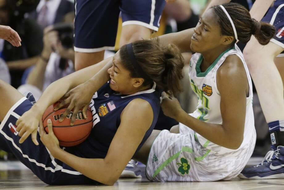 Connecticut forward Morgan Tuck (3) and Notre Dame forward Markisha Wright (34) battle for a loose ball in the second half of the women's NCAA Final Four college basketball tournament semifinal, Sunday, April 7, 2013, in New Orleans. (AP Photo/Dave Martin)