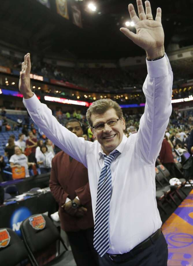Connecticut head coach Geno Auriemma waves to fans after the women's NCAA Final Four college basketball tournament semifinal against Notre Dame, Sunday, April 7, 2013, in New Orleans. UConn won 83-65. (AP Photo/Dave Martin)