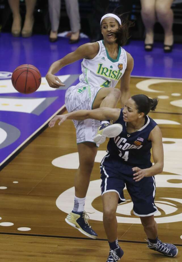 Notre Dame guard Skylar Diggins (4) blocks a shot by Connecticut guard Bria Hartley (14) in the second half of the women's NCAA Final Four college basketball tournament semifinal, Sunday, April 7, 2013, in New Orleans. (AP Photo/Bill Haber)