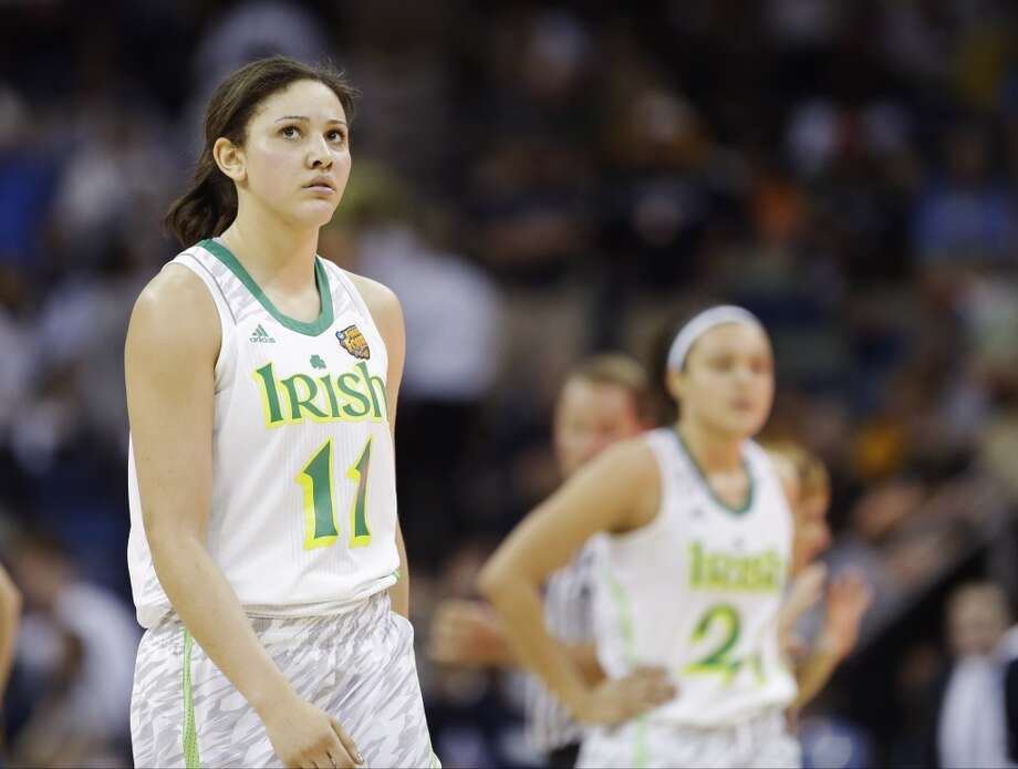 Notre Dame forward Natalie Achonwa (11) looks at the clock during a timeout in the second half of the women's NCAA Final Four college basketball tournament semifinal against Connecticut, Sunday, April 7, 2013, in New Orleans. (AP Photo/Gerald Herbert)