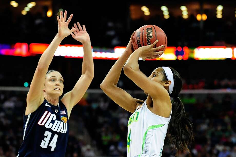 NEW ORLEANS, LA - APRIL 07:  Skylar Diggins #4 of the Notre Dame Fighting Irish shoots in front of Kelly Faris #34 of the Connecticut Huskies during the National Semifinal game of the 2013 NCAA  Division I Women's Basketball Championship at the New Orleans Arena on April 7, 2013 in New Orleans, Louisiana.  Connecticut won the game 83-65.  (Photo by Stacy Revere/Getty Images)