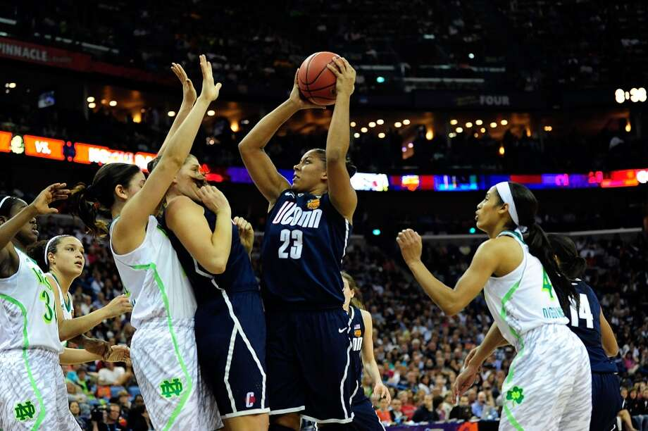 NEW ORLEANS, LA - APRIL 07:  Kaleena Mosqueda-Lewis #23 of the Connecticut Huskies shoots against the Notre Dame Fighting Irish during the National Semifinal game of the 2013 NCAA Division I Women's Basketball Championship at New Orleans Arena on April 7, 2013 in New Orleans, Louisiana. Connecticut won the game 83-65.   (Photo by Stacy Revere/Getty Images)