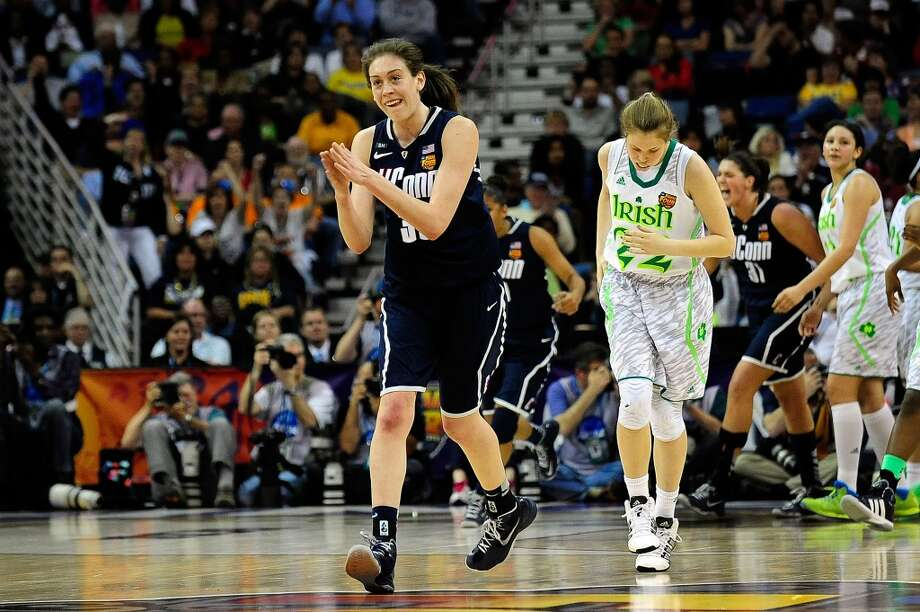 NEW ORLEANS, LA - APRIL 07:  Breanna Stewart #30 of the Connecticut Huskies reacts to a three point shot against the Notre Dame Fighting Irish during the National Semifinal game of the 2013 NCAA  Division I Women's Basketball Championship at the New Orleans Arena on April 7, 2013 in New Orleans, Louisiana.  Connecticut won the game 83-65.  (Photo by Stacy Revere/Getty Images)
