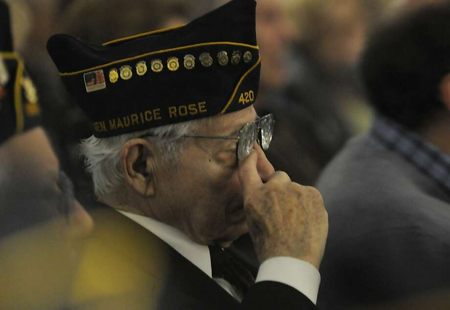 World War II veteran Hebert Isner of Oak Park, Mich., wipes his during the Yom HaShoah, Holocaust Day of Remembrance at the Holocaust Memorial Center in Farmington Hills, Mich., on Sunday, April 7, 2013.  (AP Photo/Detroit News, Elizabeth Conley) Photo: Elizabeth Conley, Associated Press