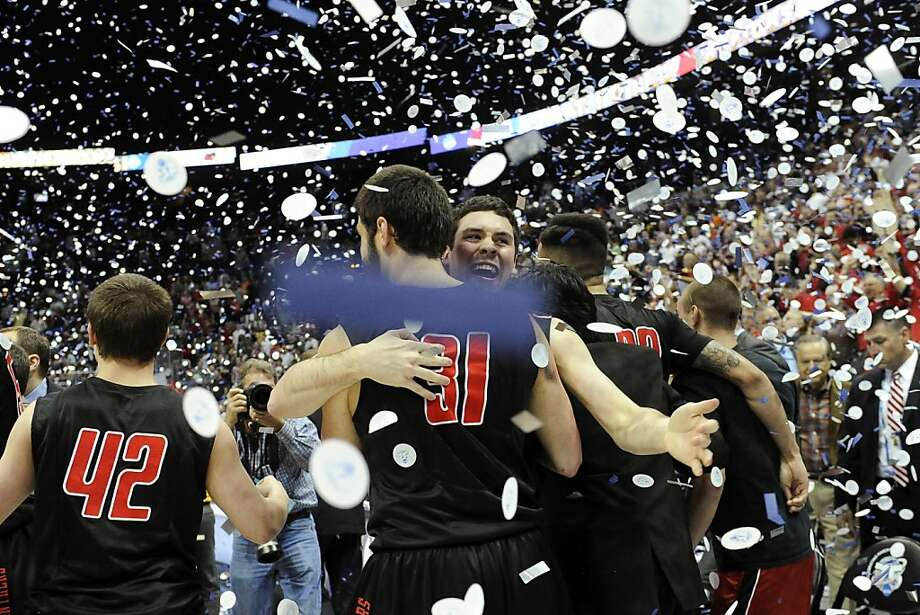 Drurys' Teddy Simniok (31) hugs Nick Schelbar as they celebrate their 74-73 win over Metro State in the NCAA Division ll national championship college basketball game, Sunday, April 7, 2013, in Atlanta. (AP Photo/John Amis) Photo: John Amis, Associated Press