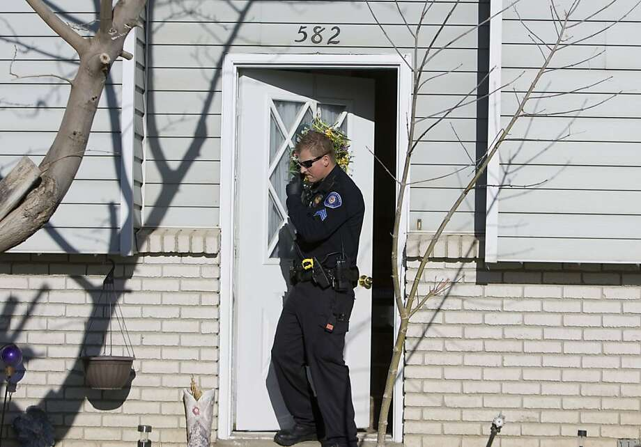 Police investigate the scene where a 5-month-old boy was shot to death in a murder-suicide attempt Friday, April 5, 2013 in American Fork, Utah. A family friend tells KSL that the father shot the baby and was about to kill himself when somebody at the house tackled him. (AP Photo/The Salt Lake Tribune, Kim Raff)  DESERET NEWS OUT; LOCAL TV OUT; MAGS OUT Photo: Kim Raff, Associated Press